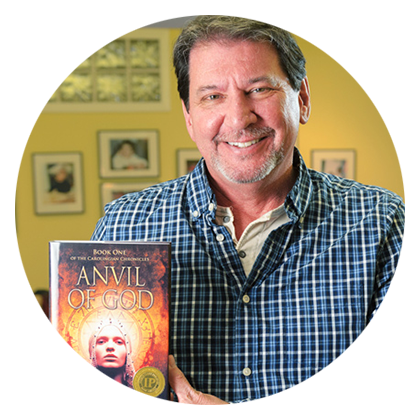 iUniverse author J. Boyce Gleason in his home holding his published book, Anvil of God.