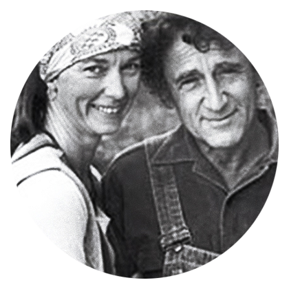 Greyscale photograph of iUniverse author Georg Rauch with wife Phyllis, outside.